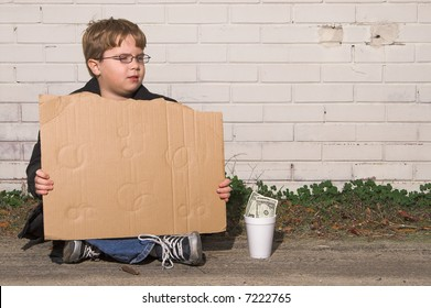 A homeless boy with a blank cardboard sign.