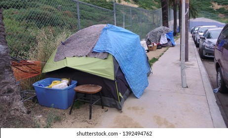 Homeless camp on a sidewalk in downtown Los Angeles, makeshift shelters made from tents and blankets. An issue that needs to be addressed.