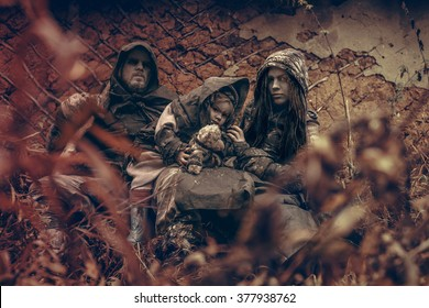 Homeless family. Refugees. Family in the forest.