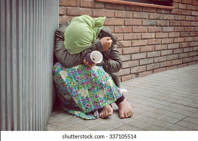 homeless girl is begging for money