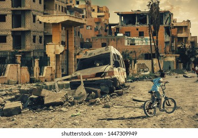 Homeless little boy riding bicycle in destroyed city, military soldiers and helicopters and tanks are still attacking the city