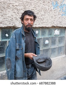 Homeless man on the street of the city