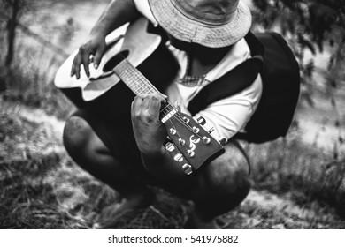 Homeless man playing guitar