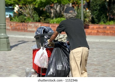 Homeless man pushing cart