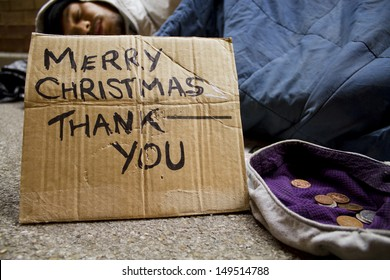 Homeless Man Sleeping Rough at Christmas. Social issues
