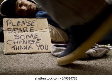 Homeless Man Sleeping Rough. Social issues concept