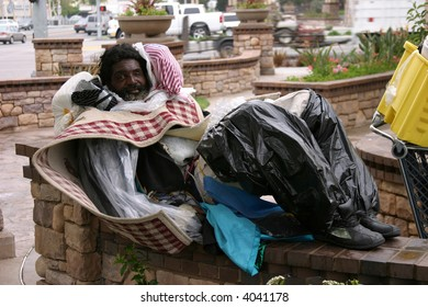 a homeless man smiles for the camera showing the plight of the homeless in california