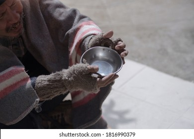 Homeless men or beggars are sad and asked to donate food or money, selective focus, empty blow