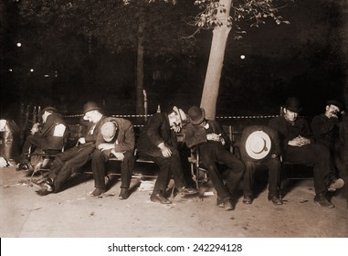 Homeless men sleeping on a park bench in New York City, 1910.