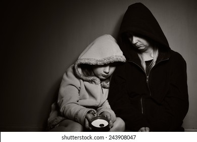 Homeless mother with her daughter. Poor family. MANY OTHER PHOTOS FROM THIS SERIES IN MY PORTFOLIO.