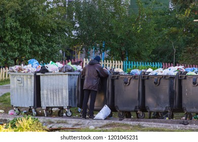 homeless people near the garbage cans