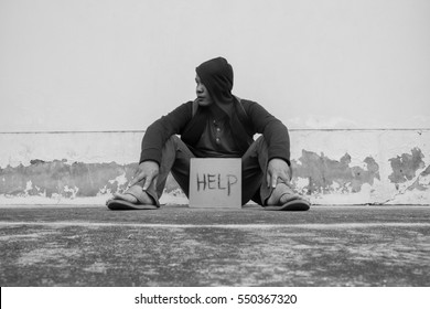 Homeless person with help sign,Poverty issue