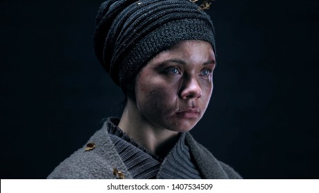 Homeless person with puffy face deeply crying, regretting about ruined life