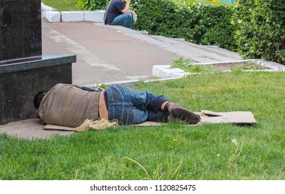 Homeless person sleeping on the grass