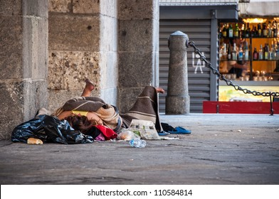 Homeless person sleeping on the street in Milan, Italy