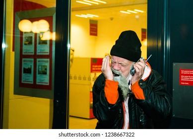 Homeless playing the harmonica Berlin December 15, 2017