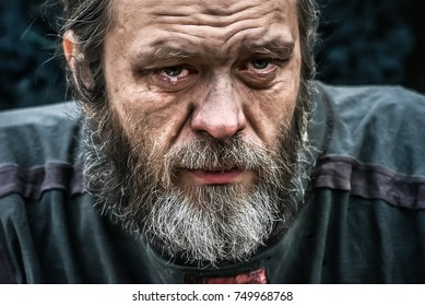homeless poor man crying portrait closeup