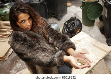homeless poor woman asking for charity on city pavement
