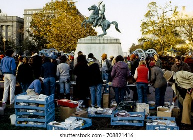 Homeless residents of local shelters are served thanksgiving dinner by the Community of Creative Non Violence in Lafayette Park directly across from the White House Washington DC,November 22nd,1984.