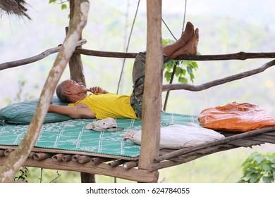 Homeless sleep inside the hut Luang Prabang 14April 2017