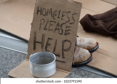 Homeless. Unhappy homeless man asking help for food donation from the people.