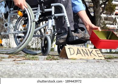 A Homeless wheelchair user asking for money