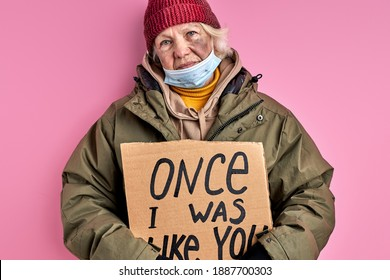 homeless woman without home hold cardboard with iscription ONCE I WAS LIKE YOU, social issues concept. female needs shelter and food