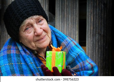 Homeless women with Christmas gift