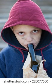homeless young boy drink alcohol