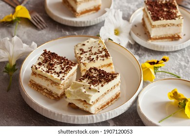 Homemade 3 bit cake. Cake with cream, pudding, butterscotch and dark chocolate. Creamy biscuit cake.