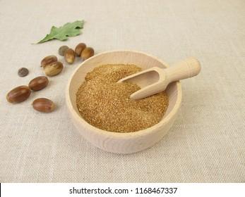 Homemade acorn flour in wooden bowl
