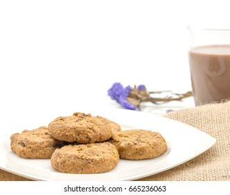 homemade almond cookies with chocolate milk on white background - copy space for text