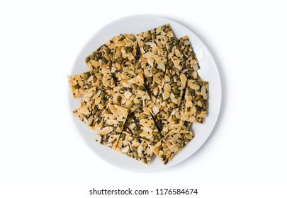 Homemade almond slice, pumpkin seeds and black sesame florentine
