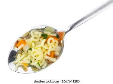 Homemade Alphabet Soup (selective focus) isolated on white background