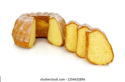 Homemade Alsatian sour cream coffee cake isolated on white background with shadow reflection. Sweet bundt cake in german called 'Gugelhupf' or 'Bundkuchen'.
