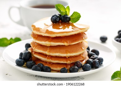 Homemade American pancakes with blueberry and golden honey. Healthy morning breakfast