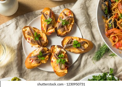 Homemade Anchovy and Sardine Crostini with Spicey Butter