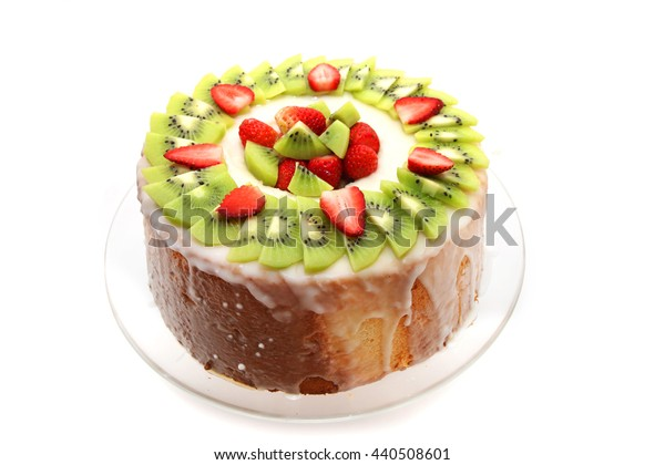 Homemade Angel Food Cake with strawberry and kiwi fruits isolated on white background