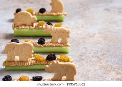 Homemade Ants on a Log Snack with Celery Peanut Butter, Raisins and Cookie