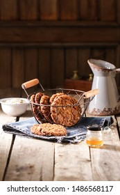 Homemade  ANZAC biscuits. Traditional Australian oatmeal and coconut cookies. Rustic style, wooden table, space for text, dark food photography