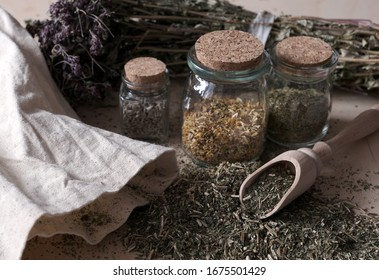 Homemade apothecary. Natural herbs medicinal. Dried herbs in glass jars and wooden spoon. Various kinds of herbal tea.