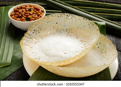 Homemade appam served with chickpeas curry