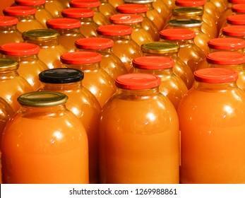 homemade apple juice in three liter glass jars