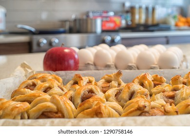 Homemade apple pastries on a counter top in a kitchen