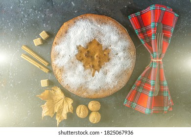 Homemade apple pie, cobbler, charlotte with walnut and cinnamon. Thanksgiving dish serving with checkered napkin. Autumn harvest festival. Flat lay, backlight