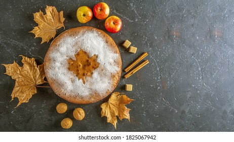 Homemade apple pie, cobbler, charlotte with walnut and cinnamon. Thanksgiving dish and fall dry leaves on rustic table. Autumn harvest festival. Copy space for text