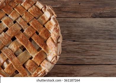 Homemade apple pie dessert on a wooden table closeup. Top view with copy space