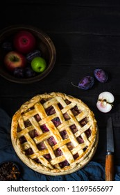 Homemade apple pie on brown wooden table.Top view. Style rustic.