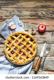 Homemade apple pie on wooden table.Top view. Style rustic.