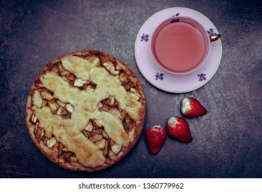 Homemade apple pie, served with tea in a vintage tea cup